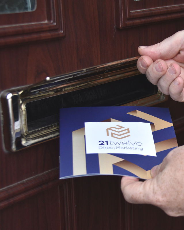 Posting a leaflet through a letterbox
